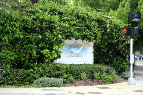 The front entrance sign to the Sandcastle Resort