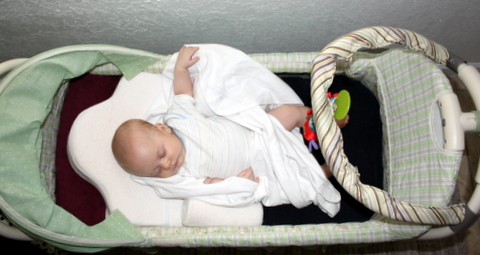 Toren lounging in his bassinet