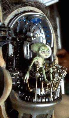 little alien controlling a human from Men in Black