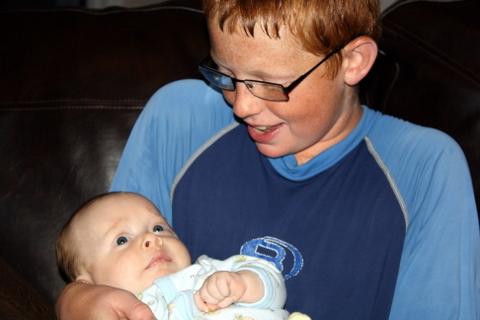 Carson holding Toren
