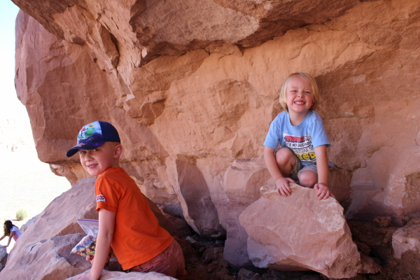 Toren and Ethan climbing on more rocks.