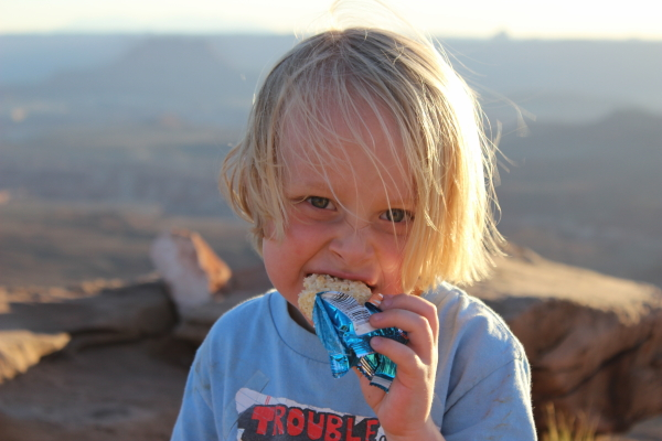 Toren waiting for the sunset, enjoying a rice krispy treat.