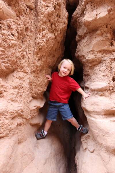 Toren climbing among the rocks.