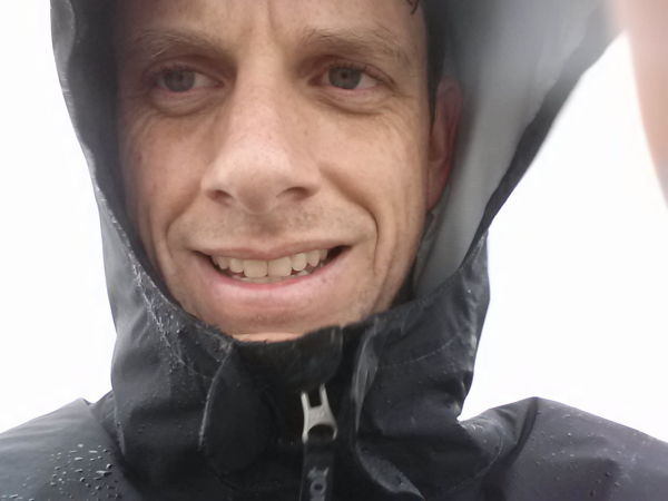 Me on the summit in the blustery wind and light, misty rain.