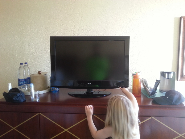 Toren trying to turn on our TV.