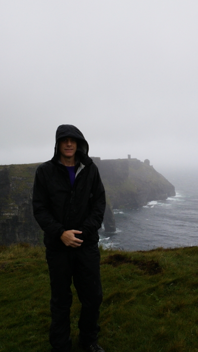 Me nearing Moher Tower on Hag's Head in the not yet terrible weather.