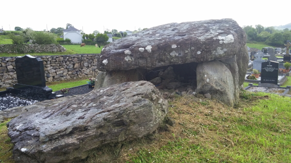 The passage tomb in Craughaun Cemetery.
