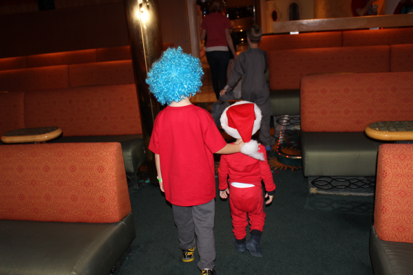 Toren walking with his cousin Zach out of the Suessapalooza show.