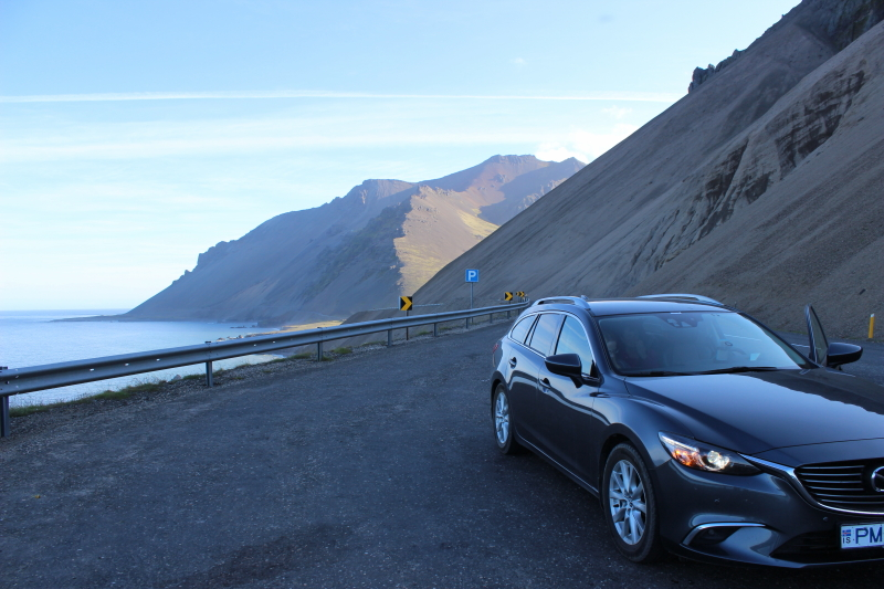 our car on the cliffs on the way to Djúpivogur