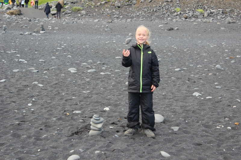 Toren with a rock pile he built on the black sand of Reynisfjara