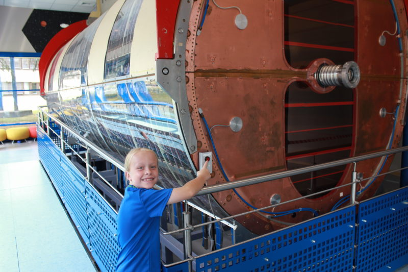 "Toren pushing the ""self-destruct"" button on an old collider. It was a red button with no label, so I told him it was the self-destruct button and he immediately proceeded to push it."