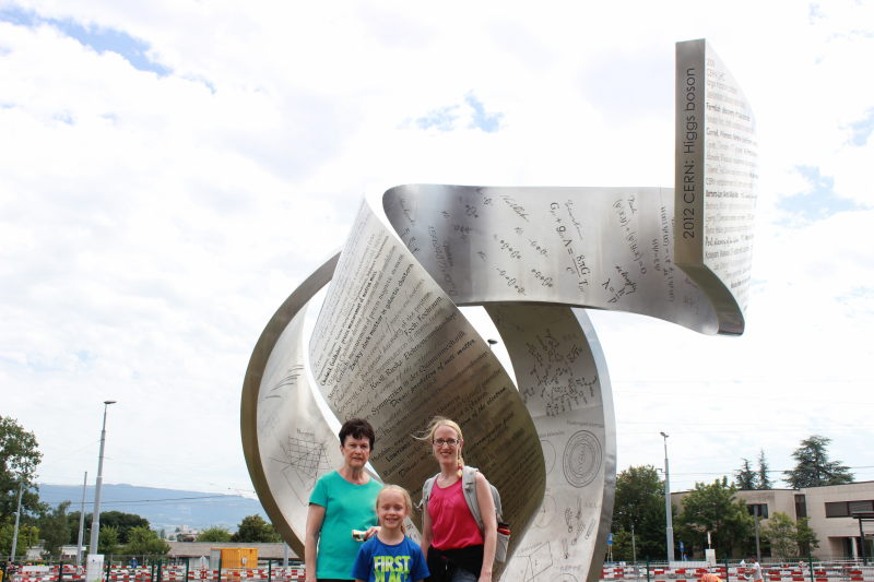 Rosemary, Toren, and Debi by a monument at CERN.